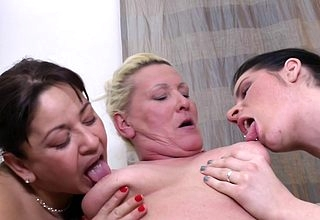 Two ageold together with young lesbians kissing together with trample