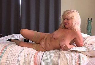 Classy mature lassie playing just about herself in bed